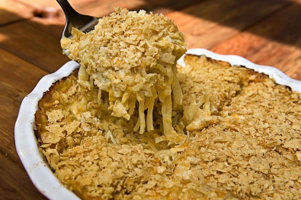 """<p><strong>Recipe: <a href=""""https://www.foodnetwork.com/recipes/ree-drummond/funeral-potatoes-3268651"""" rel=""""nofollow noopener"""" target=""""_blank"""" data-ylk=""""slk:Funeral Potatoes"""" class=""""link rapid-noclick-resp"""">Funeral Potatoes</a></strong></p> <p>Funeral potatoes are beloved below the Mason-Dixon. Cheesy, crunchy, and oh-so creamy, this casserole is a forever classic. </p>"""