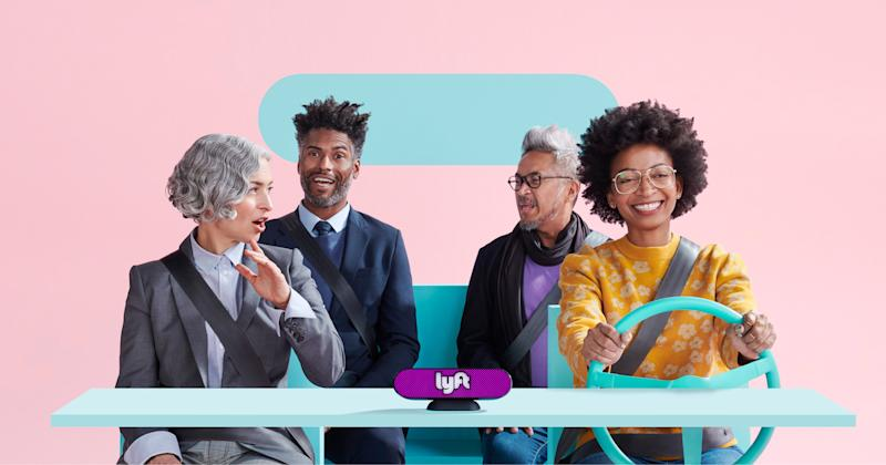 Four people in a simulated car with a Lyft logo.