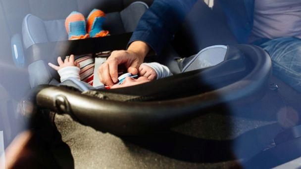 PHOTO: In this undated stock photo, a mother puts her baby in a rear facing car set. (STOCK PHOTO/Getty Images)