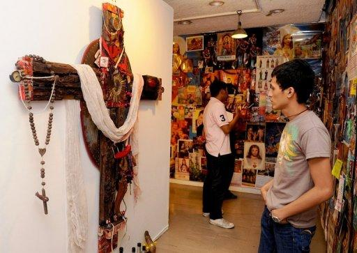 College students attend an exhibition at a government-run cultural centre in Manila