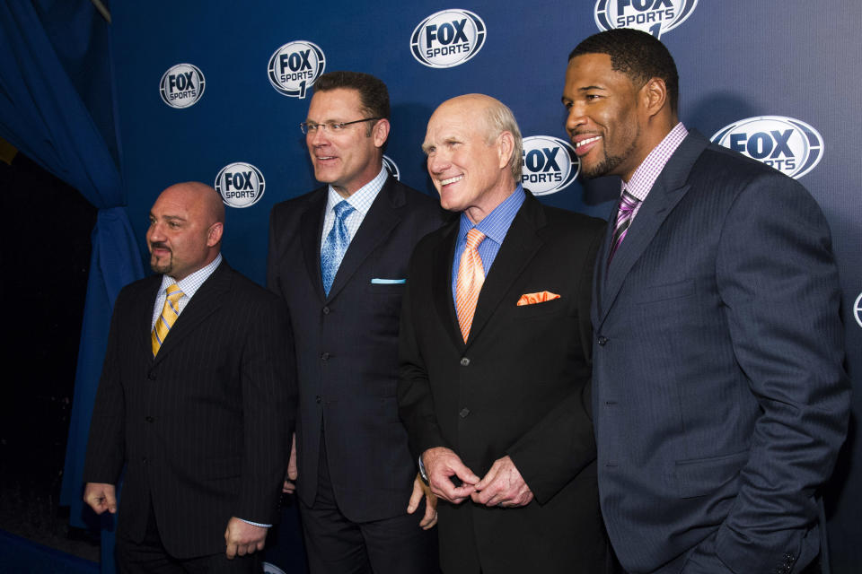 FILE - This March 5, 2013, file photo shows Jay Glazer, from left, Howie Long, Terry Bradshaw and Michael Strahan attending the Fox Sports Media Upfront party celebrating the new Fox Sports 1 network in New York. Bradshaw thought his career as a football analyst was over in 1993 when CBS lost the NFL rights to Fox. Instead of going back to cattle ranching, he has had a front-row seat to the biggest sports broadcasting story of the past quarter century.  (Photo by Charles Sykes/Invision/AP, File)