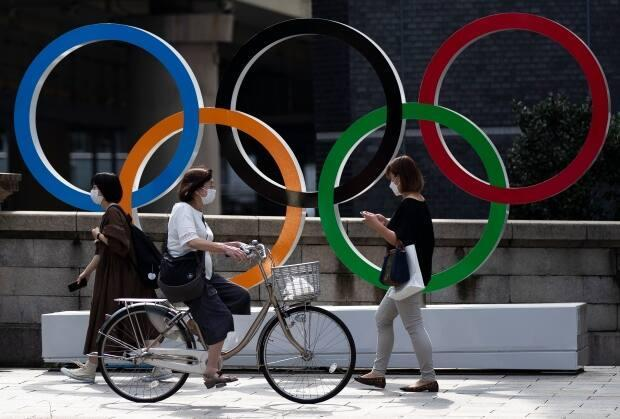The Tokyo 2020 Olympics are underway. From what citizens of Japan think about the Games to COVID-19 safety measures, we answer your questions. (Hiro Komae/The Associated Press - image credit)