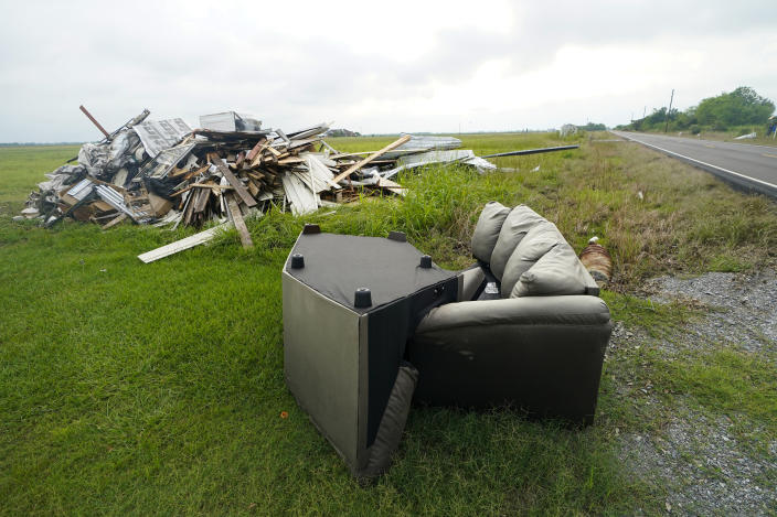 Debris from Hurricane Laura is pilled up in Bell City, La., Thursday, Oct. 8, 2020, as Hurricane Delta approached the Gulf Coast. Louisiana residents still recovering from the devastation of a powerful hurricane less than two months ago braced for another hit as Hurricane Delta steamed north through the Gulf on Thursday after swiping Mexico's Yucatan Peninsula. (AP Photo/Gerald Herbert)