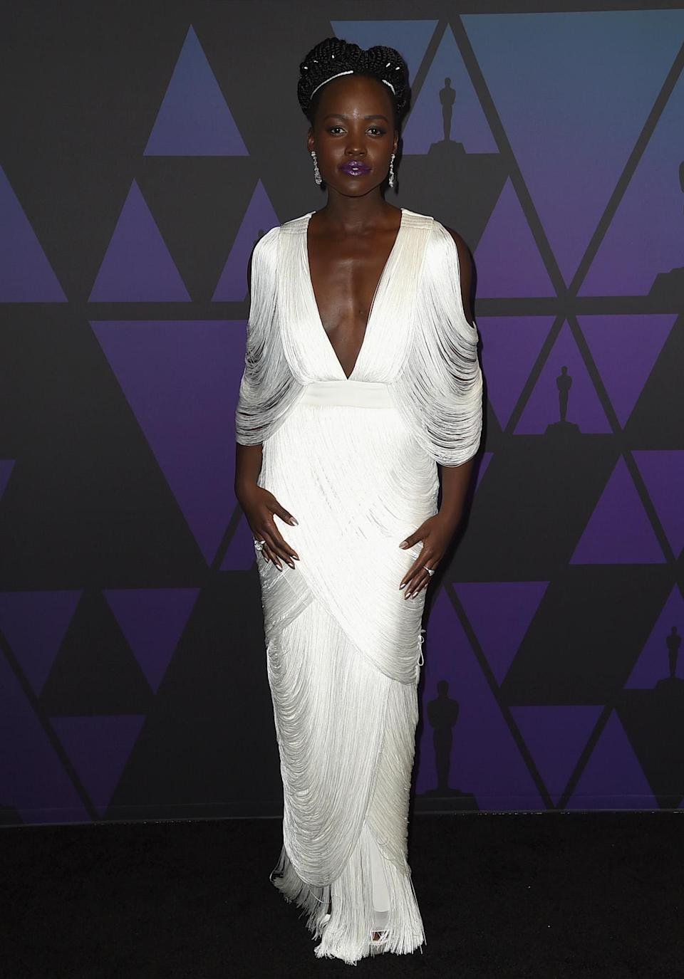 <p>For the evening, the actress dressed in a fringed Tom Ford gown finished with Anabela Chan diamond earrings. <em>[Photo: Getty]</em> </p>