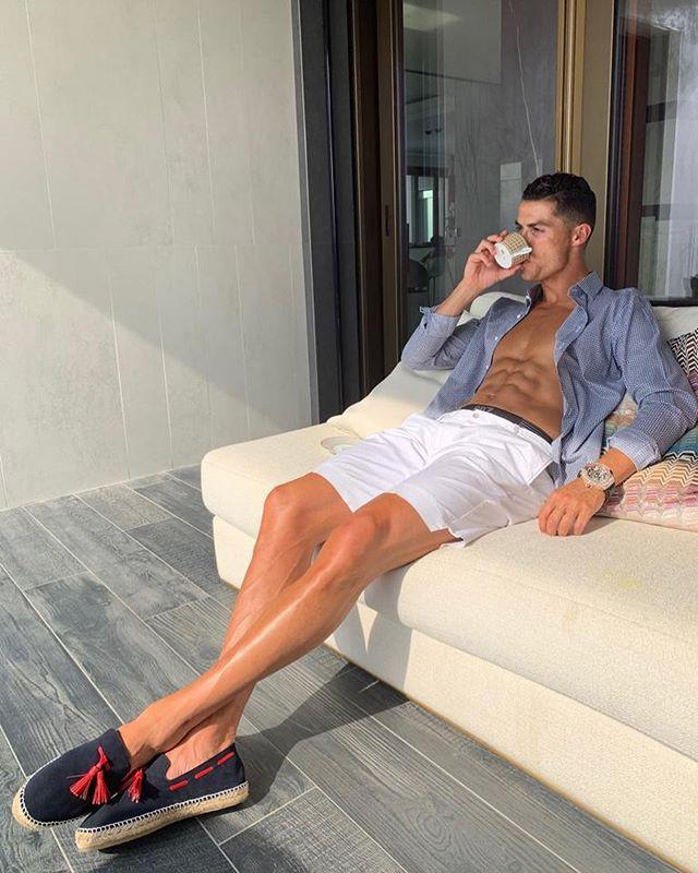 """<p>Next time you are lounging with a cup of tea, take some inspiration from this July 2019 Ronaldo photo. The unbuttoned shirt, exposed abs, and questionable shoe selection are all mandatory.</p><p><a href=""""https://www.instagram.com/p/B0EEd1KgNMn/"""" rel=""""nofollow noopener"""" target=""""_blank"""" data-ylk=""""slk:See the original post on Instagram"""" class=""""link rapid-noclick-resp"""">See the original post on Instagram</a></p>"""