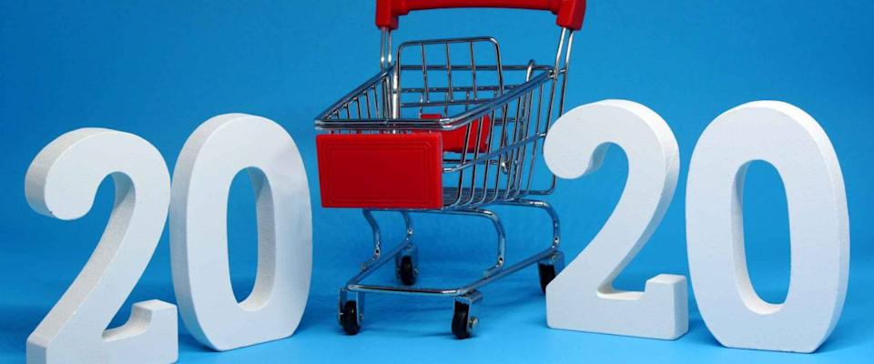Shopping Cart isolated blue background with happy new year 2020 - Business Shopping stores to buy goods concept