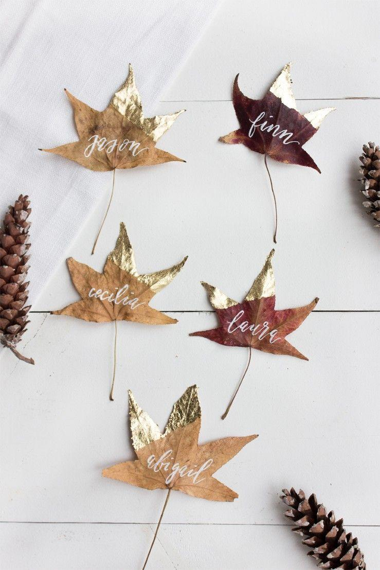 "<p>These name cards are a simple way to put that fall foliage in your yard to use and add a natural element to your place settings. You can show off your calligraphy skills if you have them and use any metallic accent color you want, <a href=""http://www.jacquelynclark.com/2014/11/26/thanksgiving-diy-place-cards/"" rel=""nofollow noopener"" target=""_blank"" data-ylk=""slk:Jacquelyn Clark of Lark & Linen says"" class=""link rapid-noclick-resp"">Jacquelyn Clark of Lark & Linen says</a>. Helpful tip: Flatten your leaves between books to make them take shape and draw out moisture.</p><p><a class=""link rapid-noclick-resp"" href=""https://go.redirectingat.com?id=74968X1596630&url=https%3A%2F%2Fwww.michaels.com%2Facrylic-paint-craft-smart-8oz%2F10411741.html&sref=https%3A%2F%2Fwww.delish.com%2Fholiday-recipes%2Fthanksgiving%2Fg33808794%2Fthanksgiving-decorations%2F"" rel=""nofollow noopener"" target=""_blank"" data-ylk=""slk:BUY NOW"">BUY NOW</a> <em><strong>Gold paint, $4.99</strong></em></p>"