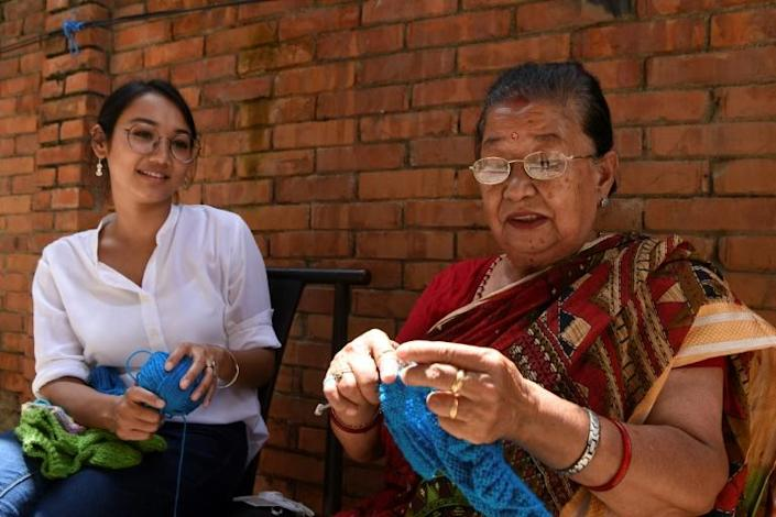 Lorina Sthapit (L, with her grandmother Champa Devi Tuladhar) says she wanted to help elders whether by promoting their creations or sharing their stories