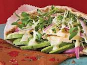 "It's easy to make a distinctive sandwich for an outdoor party when using pita breads. Here, sprouts, red onion, avocado, cheddar cheese, and a lime mayonnaise combine to make a healthy meal. <a href=""https://www.countryliving.com/recipefinder/avocado-cheddar-sprouts-pockets-tangy-lime-mayo"" rel=""nofollow noopener"" target=""_blank"" data-ylk=""slk:Get the recipe."" class=""link rapid-noclick-resp""><strong>Get the recipe.</strong></a>"