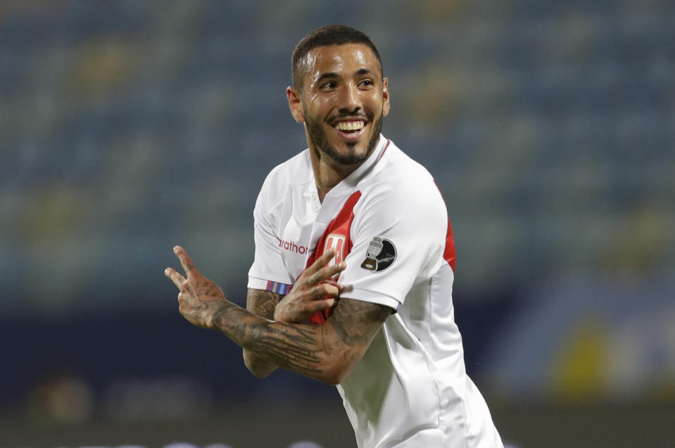 Peru's Sergio Pena celebrates after scoring his side's opening goal during a Copa America soccer match against Colombia at Olimpico stadium in Goiania, Brazil, Sunday, June 20, 2021. (AP Photo/Eraldo Peres)