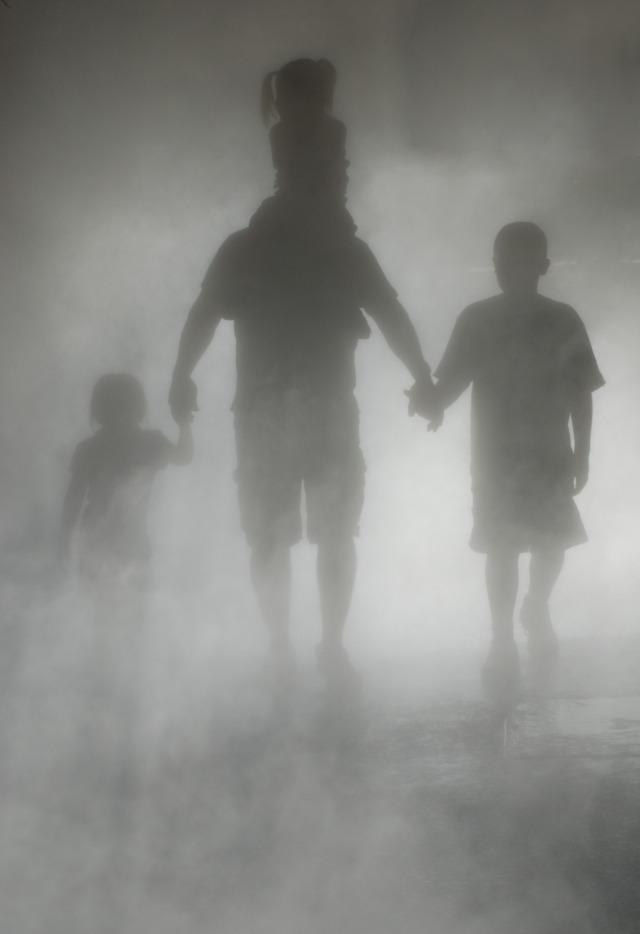 Father and children in shadows.