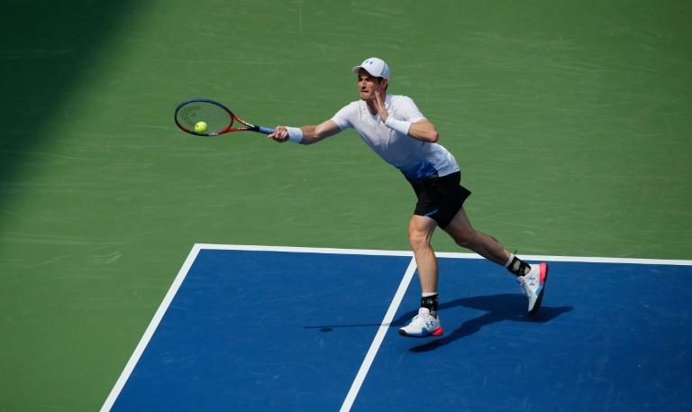 He's back: Andy Murray hits a return to James Duckworth