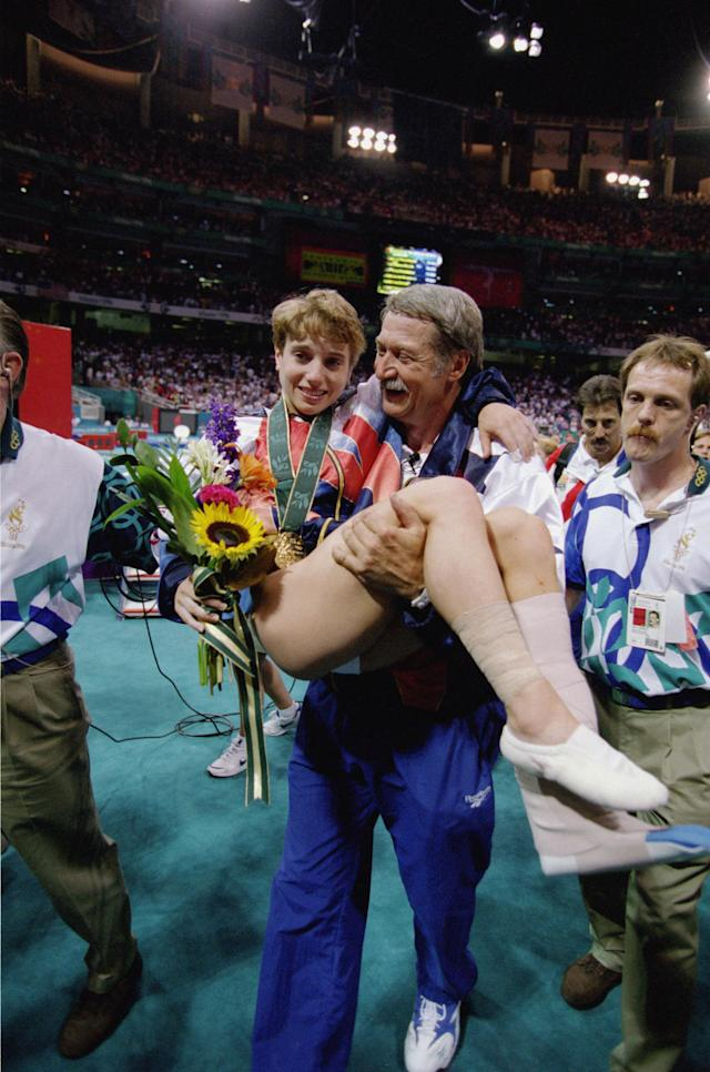 ATLANTA - JULY 23: Coach Bela Karolyi carries an injured Kerri Strug of the United States after she received her gold medal in the Womens Team Gymnastics competition at the 1996 Olympic Games on July 23, 1996 at the Georgia Dome in Atlanta, Georgia. (Photo by Doug Pensinger/Getty Images)