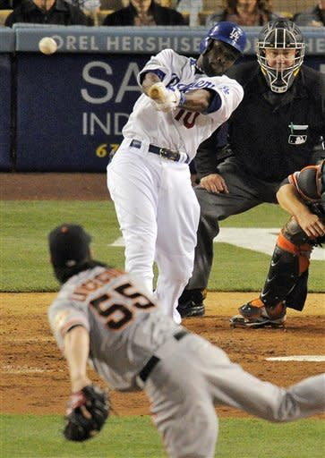 Los Angeles Dodgers' Tony Gwynn swings on a three-run triple off San Francisco Giants starting pitcher Tim Lincecum during the fourth inning of a baseball game, Wednesday, May 9, 2012, in Los Angeles. (AP Photo/Mark J. Terrill)