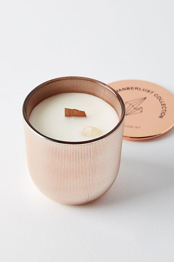 """<p><strong>Wicks and Stones Anthropologie</strong></p><p>anthropologie.com</p><p><strong>$38.00</strong></p><p><a href=""""https://go.redirectingat.com?id=74968X1596630&url=https%3A%2F%2Fwww.anthropologie.com%2Fshop%2Fwicks-and-stones-wanderlust-crystal-candle&sref=https%3A%2F%2Fwww.seventeen.com%2Flife%2Ffriends-family%2Fg722%2Fbest-holiday-gifts-for-mom%2F"""" rel=""""nofollow noopener"""" target=""""_blank"""" data-ylk=""""slk:Shop Now"""" class=""""link rapid-noclick-resp"""">Shop Now</a></p><p>Help mom relax (and balance her chakras) with this coconut, lime, and elderflower scented candle that comes with a real chunk of amethyst embedded in the wax itself.</p>"""