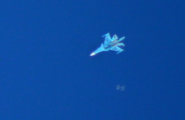 A Russian Sukhoi Su-34 fighter drops bombs over the Syrian village of Kafr Ain in the southern countryside of Idlib province on September 7, 2018