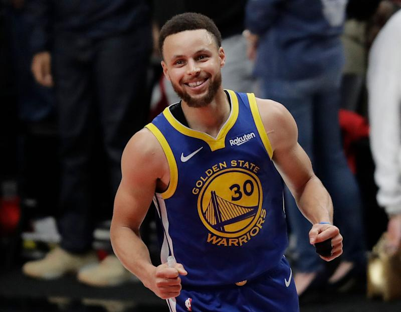 Golden State Warriors guard Stephen Curry reacts at the end of Game 4 of the NBA basketball playoffs Western Conference finals against the Portland Trail Blazers, Monday, May 20, 2019, in Portland, Ore. The Warriors won 119-117 in overtime. (AP Photo/Ted S. Warren)