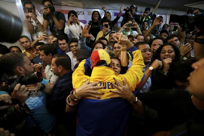 Miranda State's Gov. Henrique Capriles, center, is congratulated by his his supporters after being re-elected during an elections in Caracas, Venezuela, Sunday, Dec. 16, 2012. Capriles lost to Chavez in the country's October election, and his re-election Sunday will allow him to cement his position as Venezuela's dominant opposition leader, even as other opposition candidates floundered.(AP Photo/Fernando Llano)