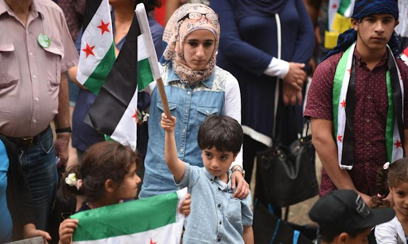 Ethnic Syrians attend a rally in support of refugees and asylum seekers in Sydney