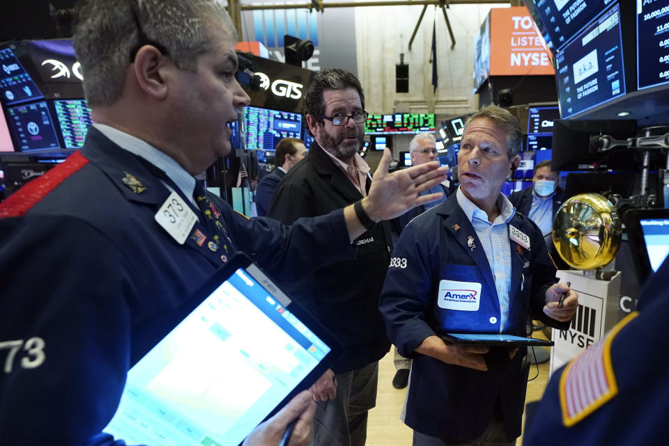 Traders confer on the floor of the New York Stock Exchange, Wednesday, Sept. 22, 2021. Stocks rose broadly on Wall Street Wednesday ahead of an update from the Federal Reserve on how and when it might begin easing its extraordinary support measures for the economy. (AP Photo/Richard Drew)