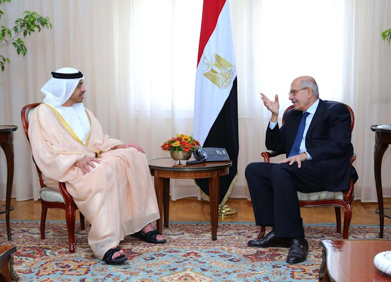 In this photo released by the Egyptian Presidency, interim Vice President Mohamed ElBaradei speaks with United Arab Emirates Foreign Minister Sheikh Abdullah bin Zayed in Cairo, Egypt, Sunday, Aug. 4, 2013. (AP Photo/Egypt Presidency)