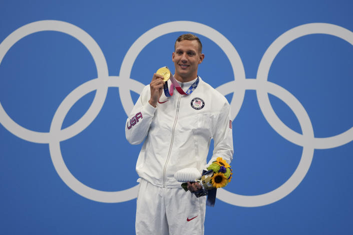 Caeleb Dressel of the United States poses with his gold medal for the men's 100-meter freestyle at the 2020 Summer Olympics, Thursday, July 29, 2021, in Tokyo, Japan. (AP Photo/Matthias Schrader)