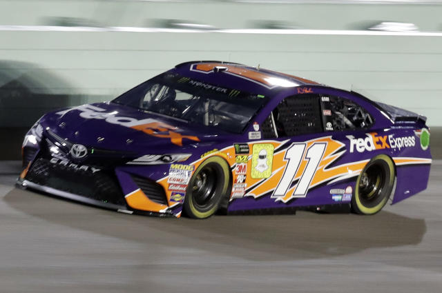 Denny Hamlin drives on the track during qualifying for the NASCAR Cup Series auto race at the Homestead-Miami Speedway, Friday, Nov. 16, 2018, in Homestead, Fla. Hamlin took the pole position. (AP Photo/Lynne Sladky)