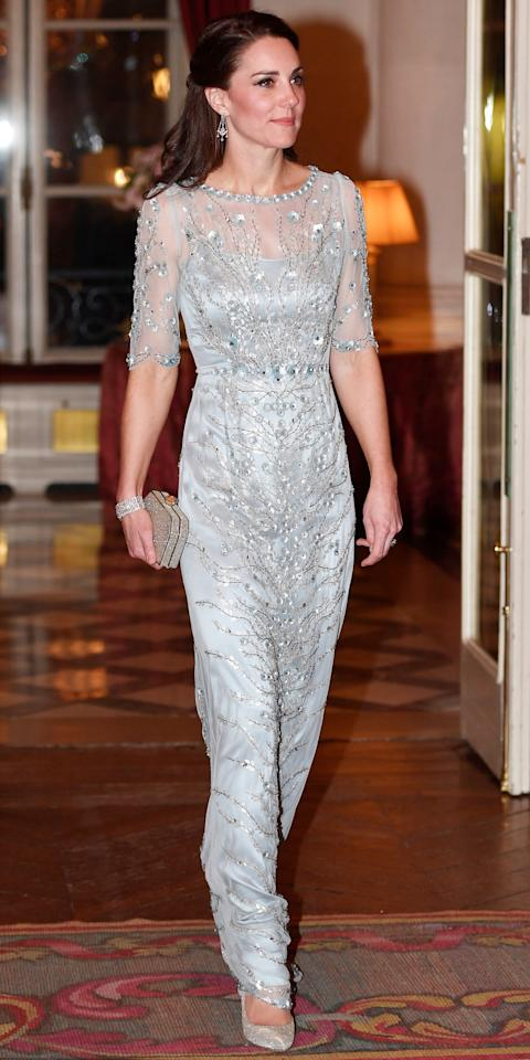 <p>While attending a dinner at the British Embassy in Paris, the Duchess wowed in a dazzling metallic Jenny Packham gown that featured delicate embellishments. She completed her look with a perfectly styled blowout, sparkling earrings and matching bracelet, silver pumps, and a glittering clutch.</p>