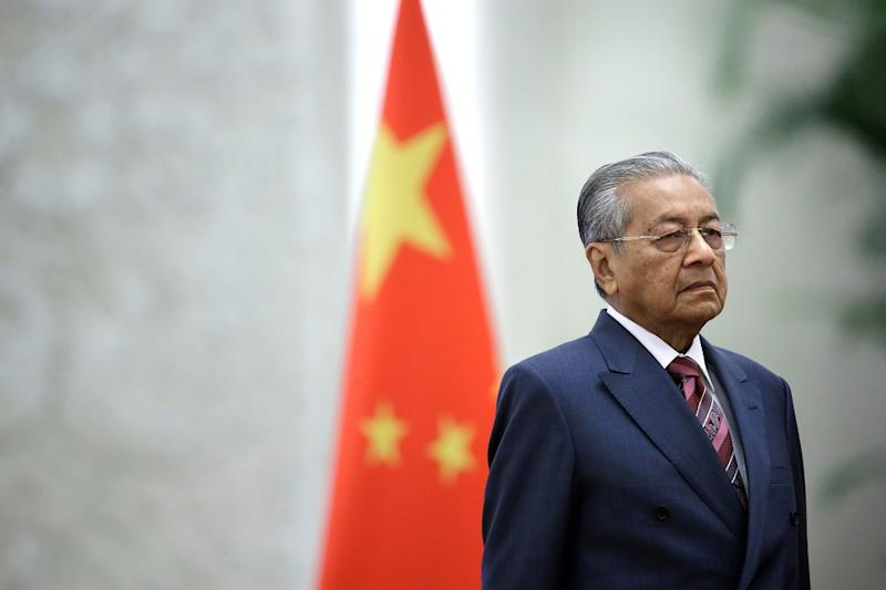 Prime Minister Tun Dr Mahathir Mohamad attends a welcome ceremony at the Great Hall of the People in Beijing August 20, 2018. — Reuters pic