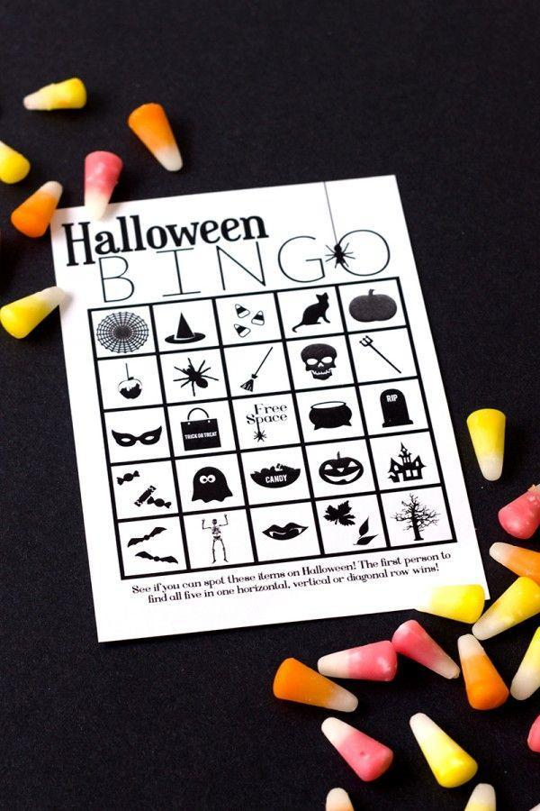 """<p>This Halloween board swaps out snoozy numerals (boring!) for witch hats, ghosts, and black cats. Purchase a bag of colorful candy corn to use as markers. </p><p><em><a href=""""http://www.studiodiy.com/2013/10/29/free-printable-halloween-bingo/"""" rel=""""nofollow noopener"""" target=""""_blank"""" data-ylk=""""slk:Get a free printable board at Studio DIY »"""" class=""""link rapid-noclick-resp"""">Get a free printable board at Studio DIY »</a></em> </p>"""