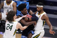 Villanova forward Brandon Slater (3) is defended by Baylor guard Matthew Mayer (24) and Flo Thamba (0) in the second half of a Sweet 16 game in the NCAA men's college basketball tournament at Hinkle Fieldhouse in Indianapolis, Saturday, March 27, 2021. (AP Photo/Michael Conroy)