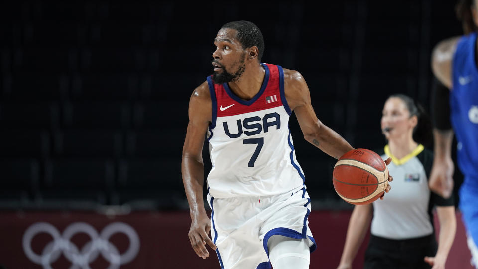 United States's Kevin Durant (7) drives up court during a men's basketball preliminary round game against the Czech Republic at the 2020 Summer Olympics, Saturday, July 31, 2021, in Saitama, Japan. (AP Photo/Charlie Neibergall)