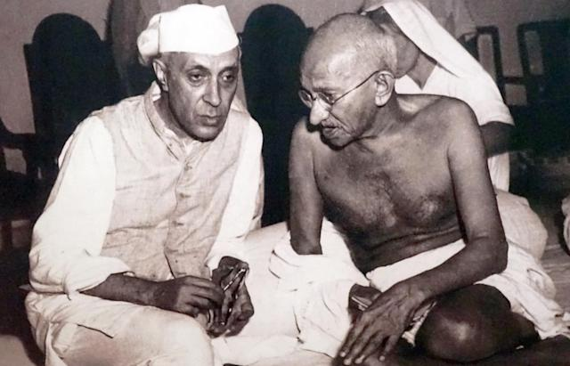 Pandit Jawaharlal Nehru, later Prime Minister of India, (left) with Mohandas Karamchand Gandhi (1869 - 1948), the preeminent leader of the Indian independence movement in British-ruled India. (Photo by: Universal History Archive/ Universal Images Group via Getty Images)