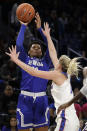 Seton Hall guard/forward Alexis Lewis, left, shoots over DePaul guard Lexi Held during the second half of an NCAA college basketball game in the Big East women's tournament semifinals, Sunday, March 8, 2020, in Chicago. (AP Photo/Nam Y. Huh)