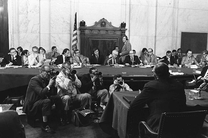 <p>Sen. Fred Thompson, third from left, listens during a hearing of the Senate Watergate Committee on Aug. 3, 1973. Testifying before the committee is Lt. Gen. Vernon Walters. (Photo: AP)Photo/Files) </p>