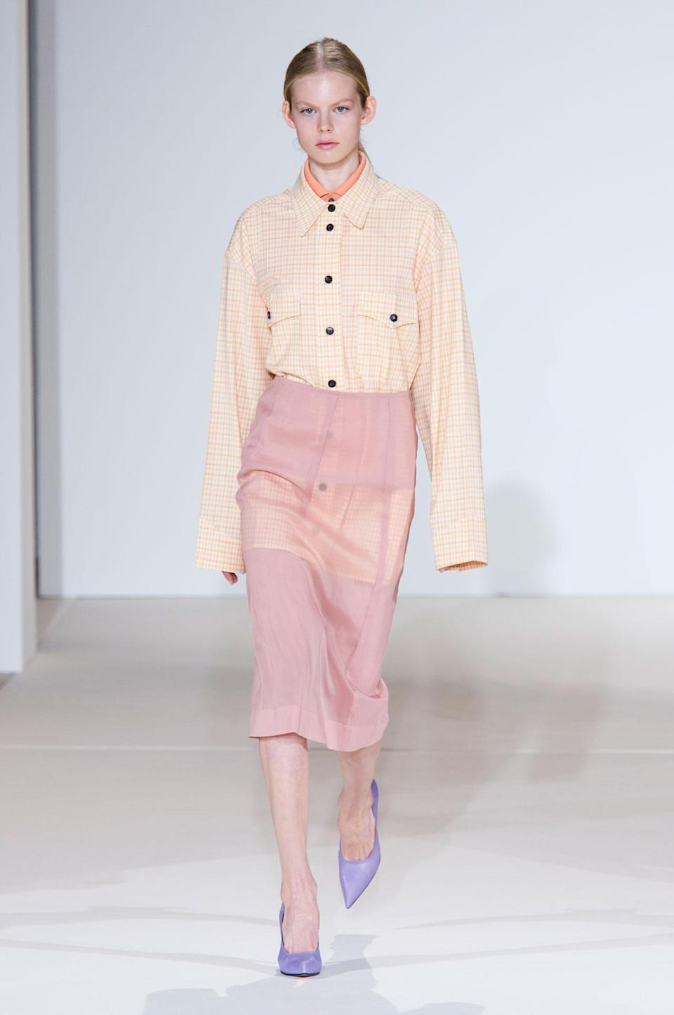 <p>Orange button up shirt and pastel pink skirt from the SS18 Victoria Beckham collection. (Photo: ImaxTree) </p>