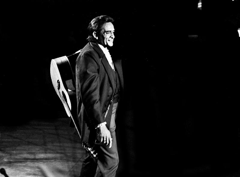 Host Johnny Cash shares a moment with the audience during the taping of