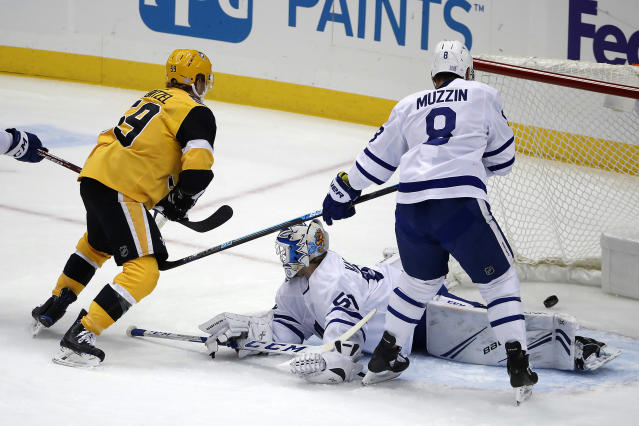 Pittsburgh Penguins' Jake Guentzel (59) gets a rebound behind Toronto Maple Leafs goaltender Kasimir Kaskisuo (50) for a goal during the first period of an NHL hockey game in Pittsburgh, Saturday, Nov. 16, 2019. (AP Photo/Gene J. Puskar)