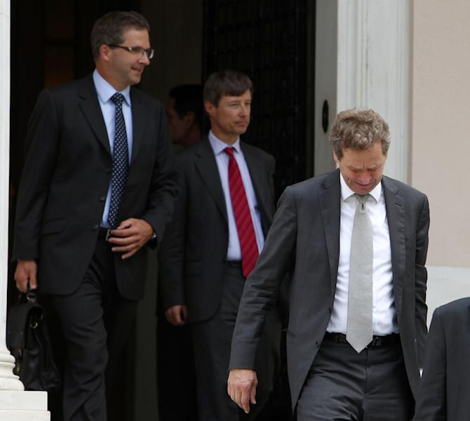 International Monetary Fund (IMF) mission chief Poul Thomsen, right, European Central Bank's (ECB) Klaus Masuch, left, and European Commission's director Matthias Mors, leave from Maximos mansion after a meeting with Greece's Prime Minister Antonis Samaras in Athens, Friday, July 27, 2012. Greece's prime minister met international austerity inspectors to outline new harsh cost-cutting reforms, without which the country would likely lose the rescue loans that are keeping it afloat. (AP Photo/Thanassis Stavrakis)