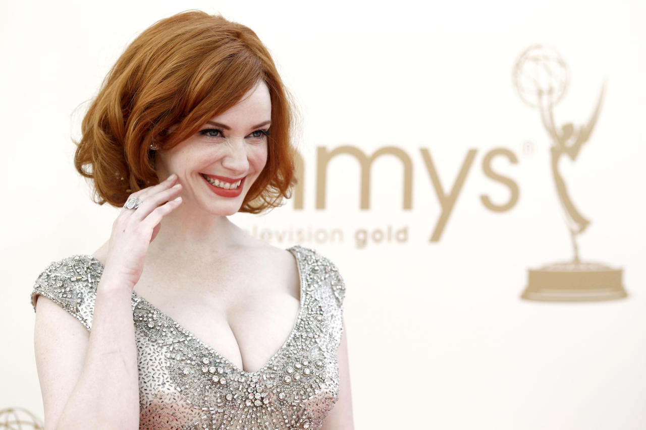 Christina Hendricks arrives at the 63rd Primetime Emmy Awards on Sunday, Sept. 18, 2011 in Los Angeles. (AP Photo/Matt Sayles)