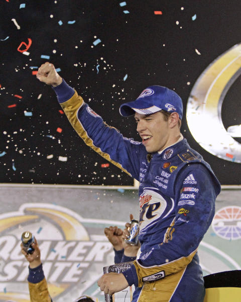 Brad Keselowski celebrates after winning the NASCAR Sprint Cup Series auto race at Kentucky Speedway in Sparta, Ky., Saturday, June 30, 2012. (AP Photo/Garry Jones)