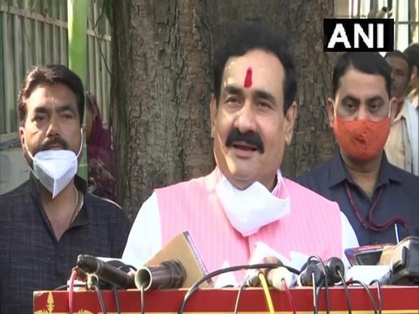 MP Home Minister Narottam Mishra addressing a press conference in Bhopal.