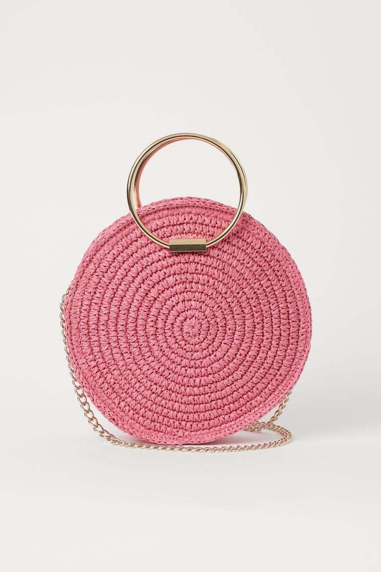 <p>This cute <span>H&amp;M Round Straw Shoulder Bag</span> ($30) is an amazing deal.</p>