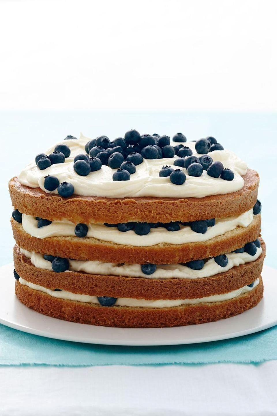 """<p> Ree Drummond's recipe leaves the sides of this cake unfrosted, so your guests know exactly what creamy and fluffy goodness they're in for.</p><p><em><a href=""""https://www.goodhousekeeping.com/food-recipes/a15612/lemon-blueberry-layer-cake-recipe-wdy0414/"""" rel=""""nofollow noopener"""" target=""""_blank"""" data-ylk=""""slk:Get the recipe for Lemon Blueberry Layer Cake »"""" class=""""link rapid-noclick-resp"""">Get the recipe for Lemon Blueberry Layer Cake »</a></em></p>"""