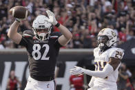 Cincinnati tight end Noah Davis (82) reacts after catching a touchdown pass during the first half of an NCAA college football game against Murray State, Saturday, Sept. 11, 2021, in Cincinnati. (AP Photo/Jeff Dean)