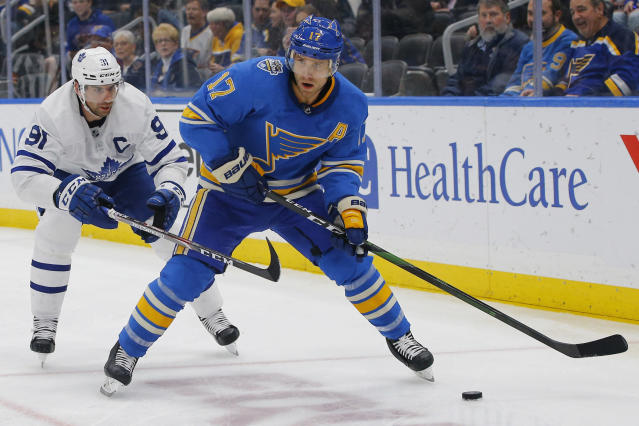 St. Louis Blues' Jaden Schwartz, right, handles the puck as he is defended by Toronto Maple Leafs' John Tavares during the second period of an NHL hockey game Saturday, Dec. 7, 2019, in St. Louis. (AP Photo/Billy Hurst)