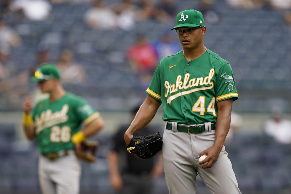 Oakland Athletics' Jesus Luzardo reacts after giving up a go-ahead solo home run to New York Yankees' Gio Urshela in the eighth inning of a baseball game, Saturday, June 19, 2021, in New York. (AP Photo/John Minchillo)
