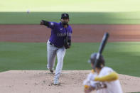 Colorado Rockies starting pitcher German Marquez throws to a San Diego Padres batter during the first inning of a baseball game Saturday, July 31, 2021, in San Diego. (AP Photo/Derrick Tuskan)