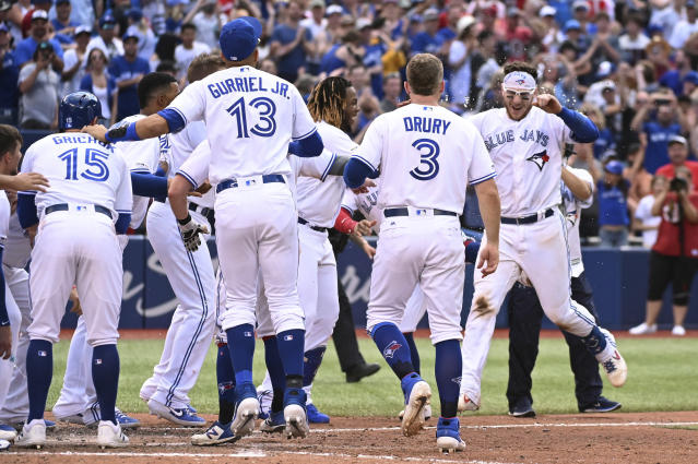 Toronto Blue Jays' Danny Jansen celebrates with teammates after hitting game-ending tow-run home run in the ninth inning against the Kansas City Royals in a baseball game in Toronto on Saturday, June 29, 2019. (Jon Blacker/The Canadian Press via AP)
