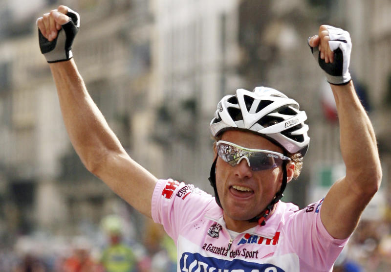 "FILE -- In this file photo taken June 3, 2007, Italy's Danilo Di Luca celebrates winning the 90th edition of the Giro d'Italia cycling race, during the Vestone to Milan stage, Italy. Former Giro d'Italia winner Danilo Di Luca tested positive for EPO in a surprise test at his home before this year's race, organizers announced Friday, May 24, 2013. If confirmed in a backup ""B'' sample, Di Luca risks a lifetime ban since this is his third offense. The test was carried out April 29, five days before the Giro started. (AP Photo/Giovanni Auletta, files)"